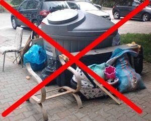 Zdjęcie przedstawiające śmietnik i śmieci przekreślone czerwonym krzyżykiem